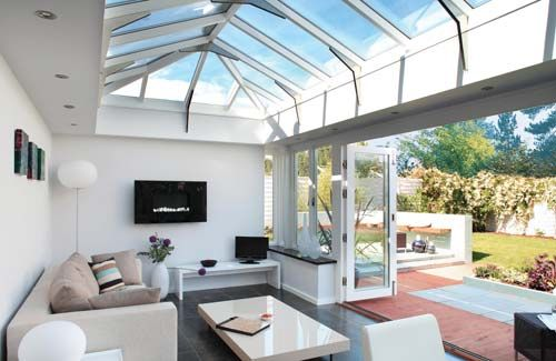 Modern style conservatory with large doors to let the garden in to your home. Image source: Channel 4