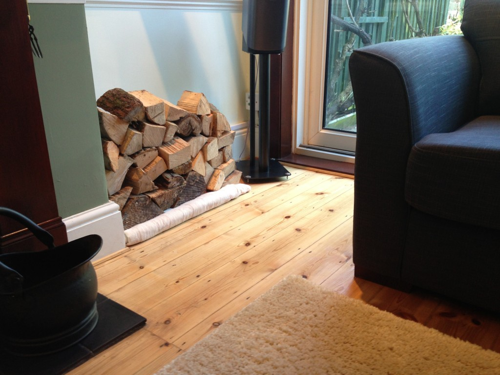Finished floorboards with furniture and rug