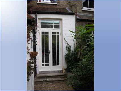 Wooden French doors with fanlight above