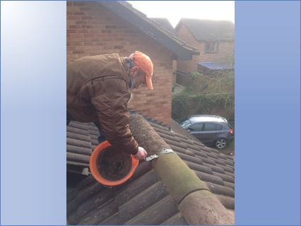 Bil replacing ridge tiles in Bidford