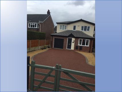 Resin driveway in red with block paving