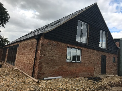 Cladding completed on cable end of barn