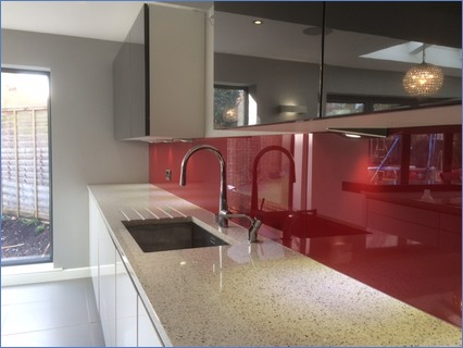 plain red glass splashback fitted