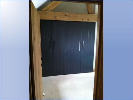 Fitted linen wardrobe painted off black