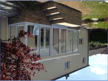 Full height conservatory with glass roof