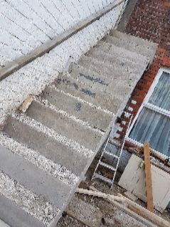 Concrete staircase after shuttering remo