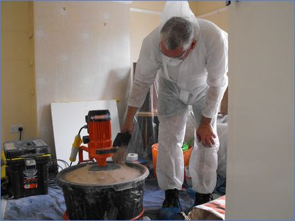 Mixing plaster and protecting the work a