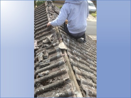 All old ridge tiles+cement removed