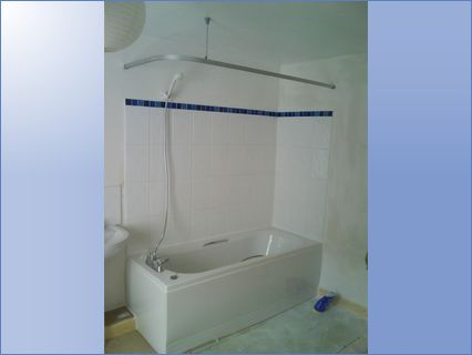 New bath fitted with shower track and ti