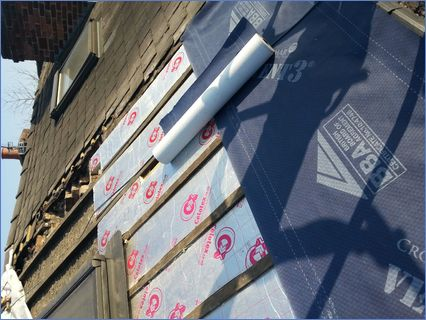 Slate re-roof with insulation between ra