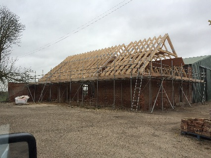 Big attic truss roof completed on barn c