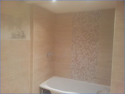 bathroom enlarged with new suite & tiled