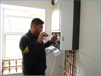 INSTALLATION OF NEW BOILER & CENTRAL HEA