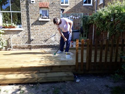 putting on the decking oil we just built