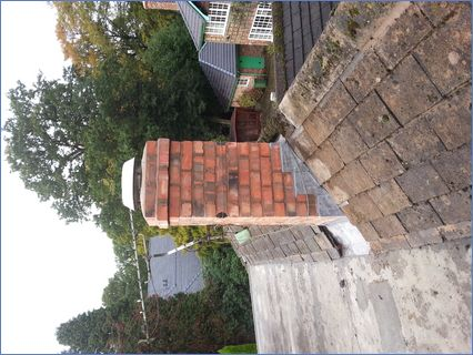 Rebuilt chimney with new lead flashings