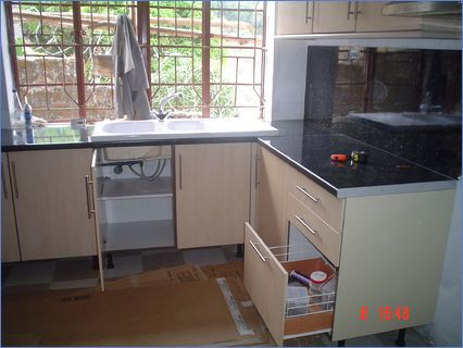 Fitted Kitchen with 15 White Ceramic Sin