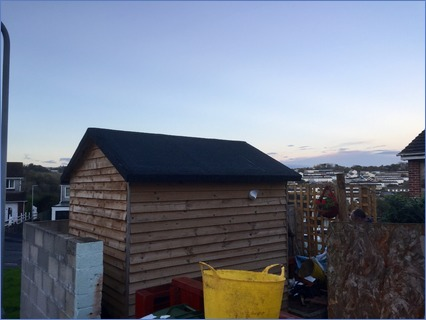 Shed roof completed with mineral capshee