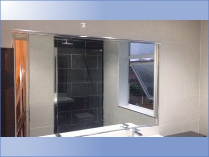 Built in large mirror with chrome surrou