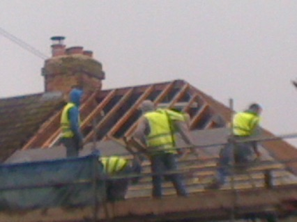 The roofing guys installing a new roof