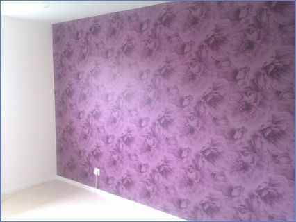 Wallpapered future wall in the bedroom