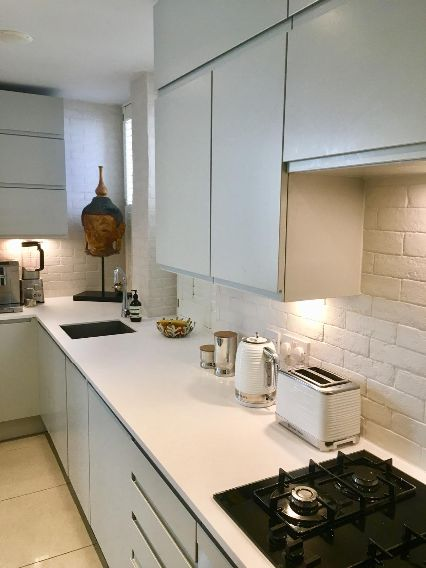 Kitchen tiling, grouting and sealing.