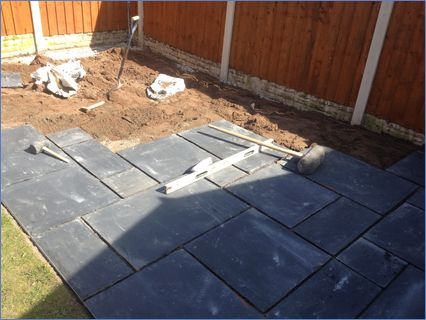 A patio in indian stone, random sizes .