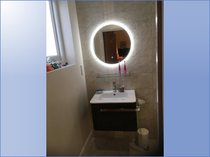 Attractive illuminated mirror and vanity