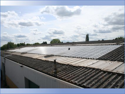 Leaking Asbestos Sheeted Roof Covered wi