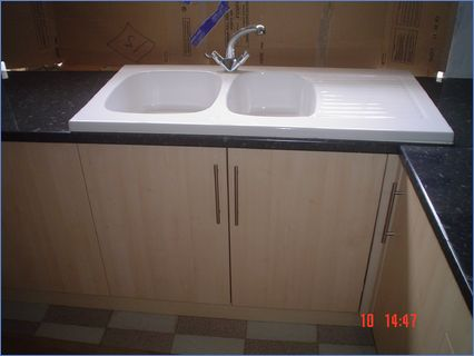 Fitted Kitchen with White Ceramic Sink