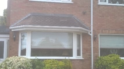 new canopy built on to a flat roof .