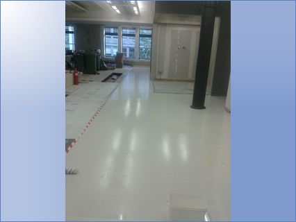 Light grey resin floor with yellow decor